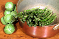 copper cookware and green vegetables