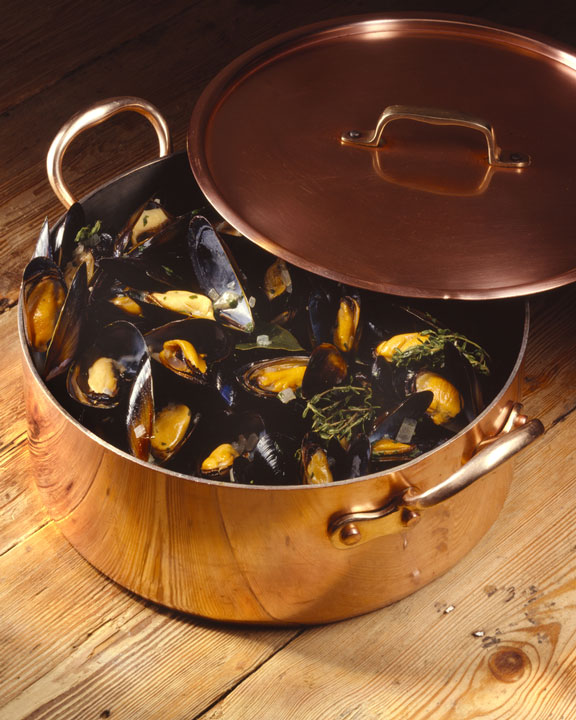 copper pot filled with mussels